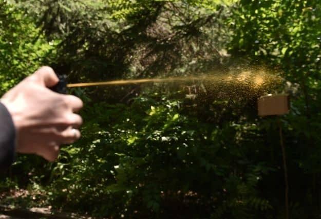 man-throwing-pepper-spray